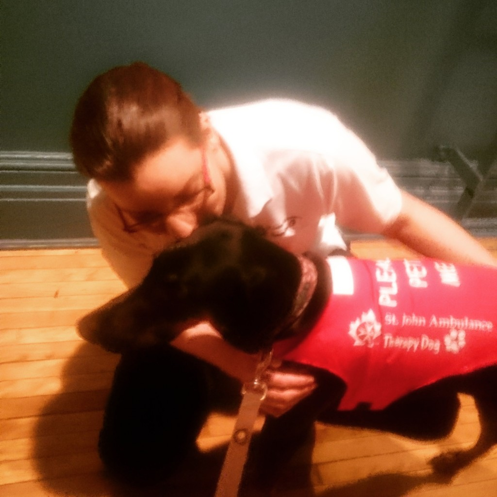 """Mary Anne Mampe fitting Athena's """"Please Pet Me"""" vest"""